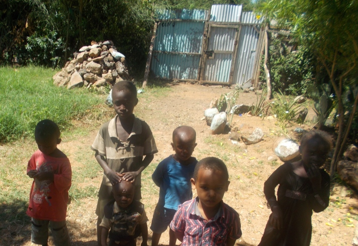 Lucas, Ero, Saimon, Lotak, Sheila and Kan stopped playing to pose for this photo taken by Ngimat Mikelina, Director of TGIM Maisha Bora Nursery School